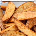 golden brown potato wedges in bowl with text overlay for Pinterest