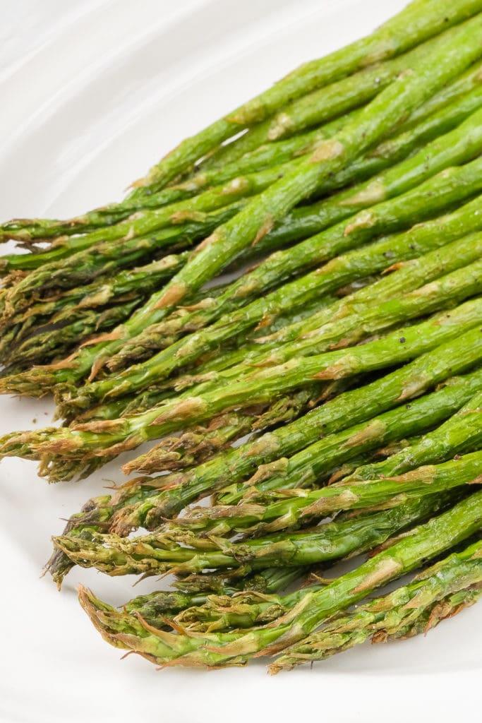 air fried asparagus on white serving dish