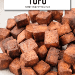 """crispy brown tofu cubes in grey bowl with text overlay saying """"crispy air fryer tofu"""""""