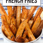 """cooked french fries in white mug with text overlay saying """"easy air fryer French fries"""""""