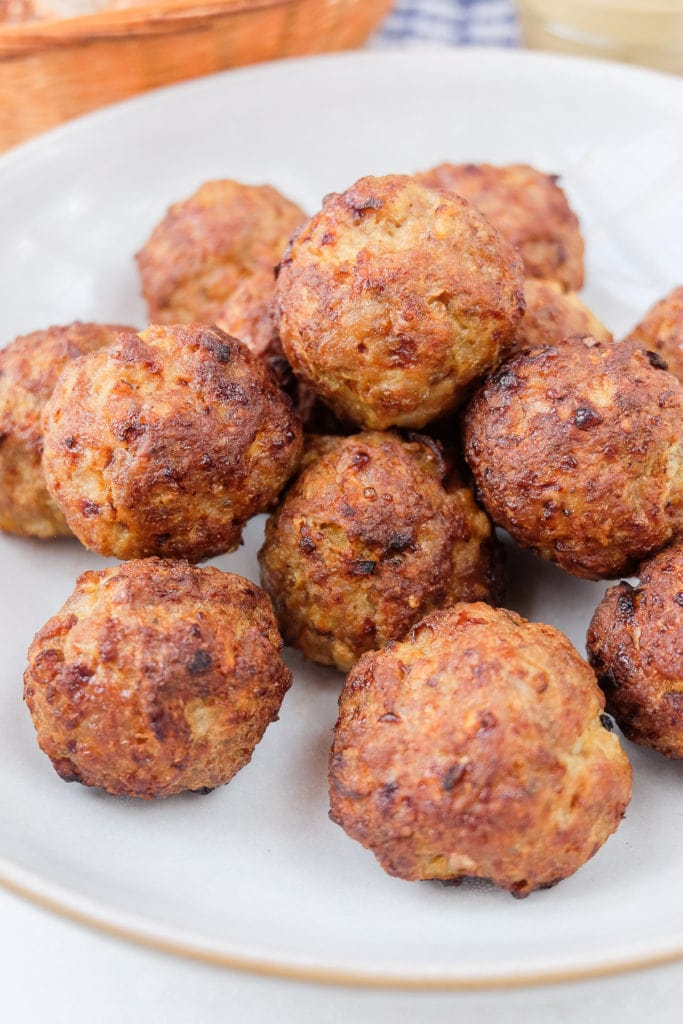 grey dish of air fried meatballs with dip behind