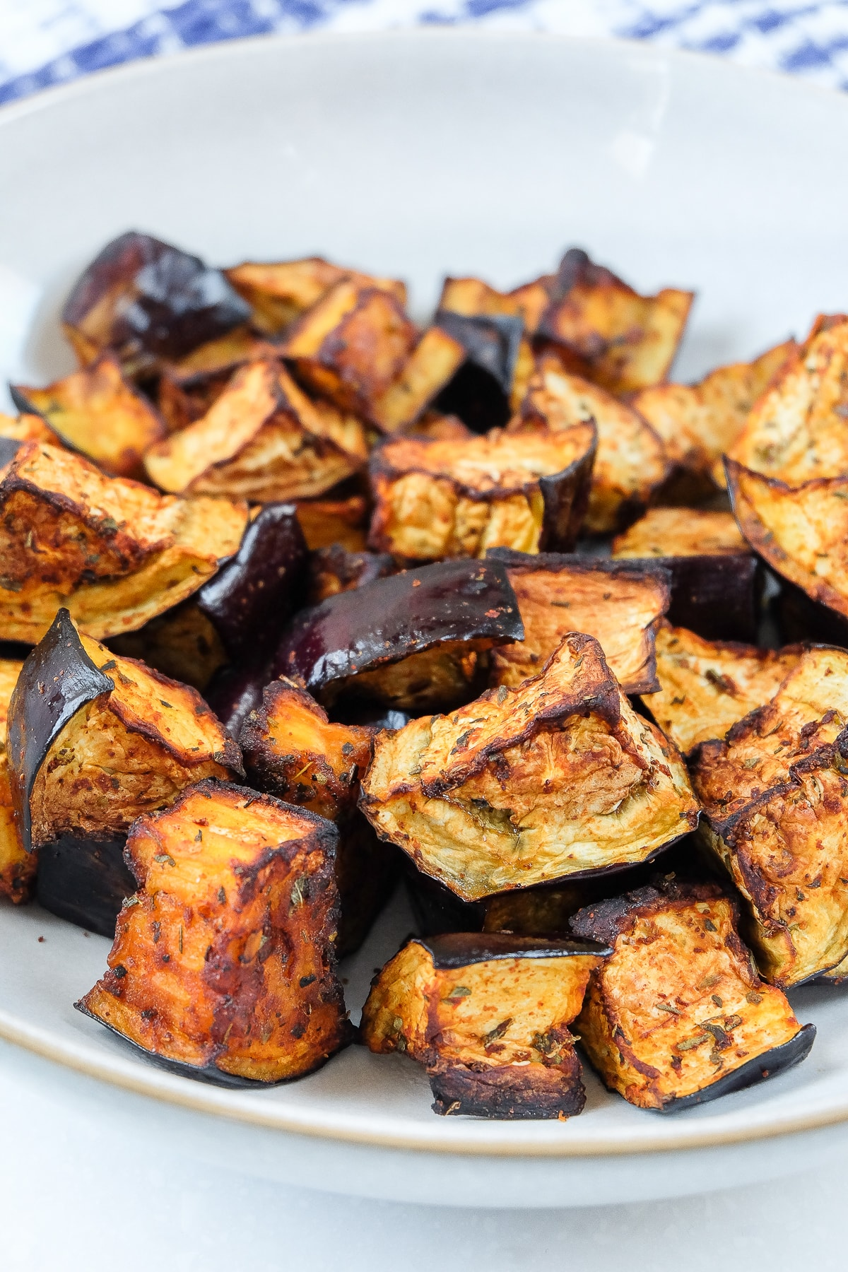 air fried eggplant with spices in bowl on counter