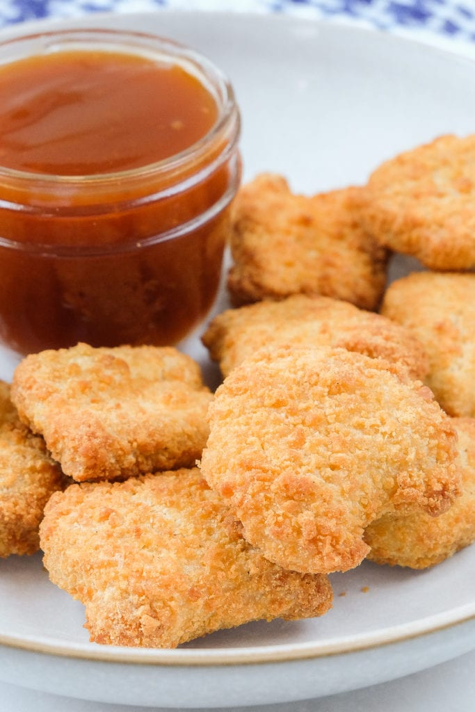 crispy chicken nuggets in bowl with dipping sauce