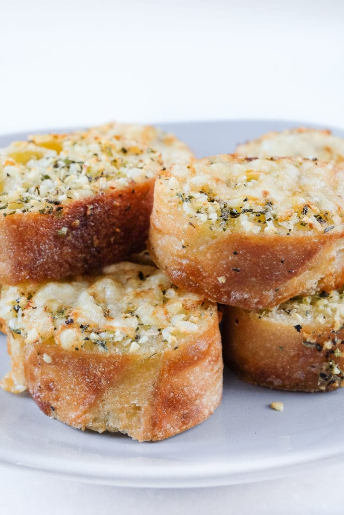 air fried garlic bread stacked on grey plate