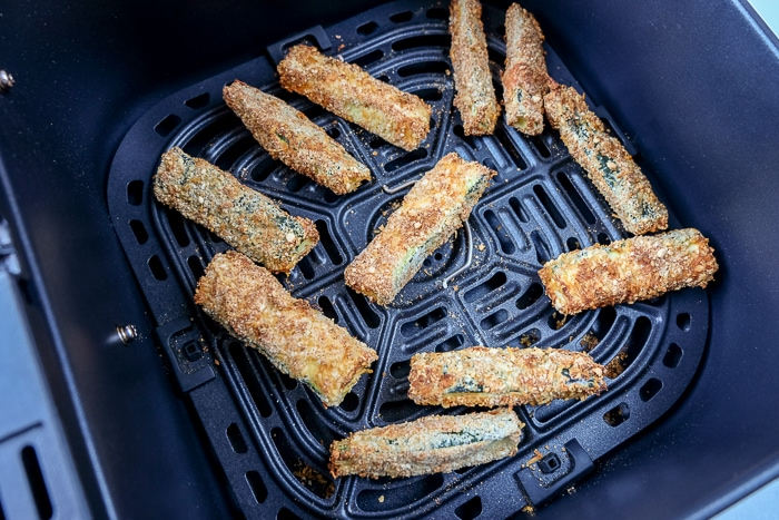 cooked zucchini fries in air fryer tray