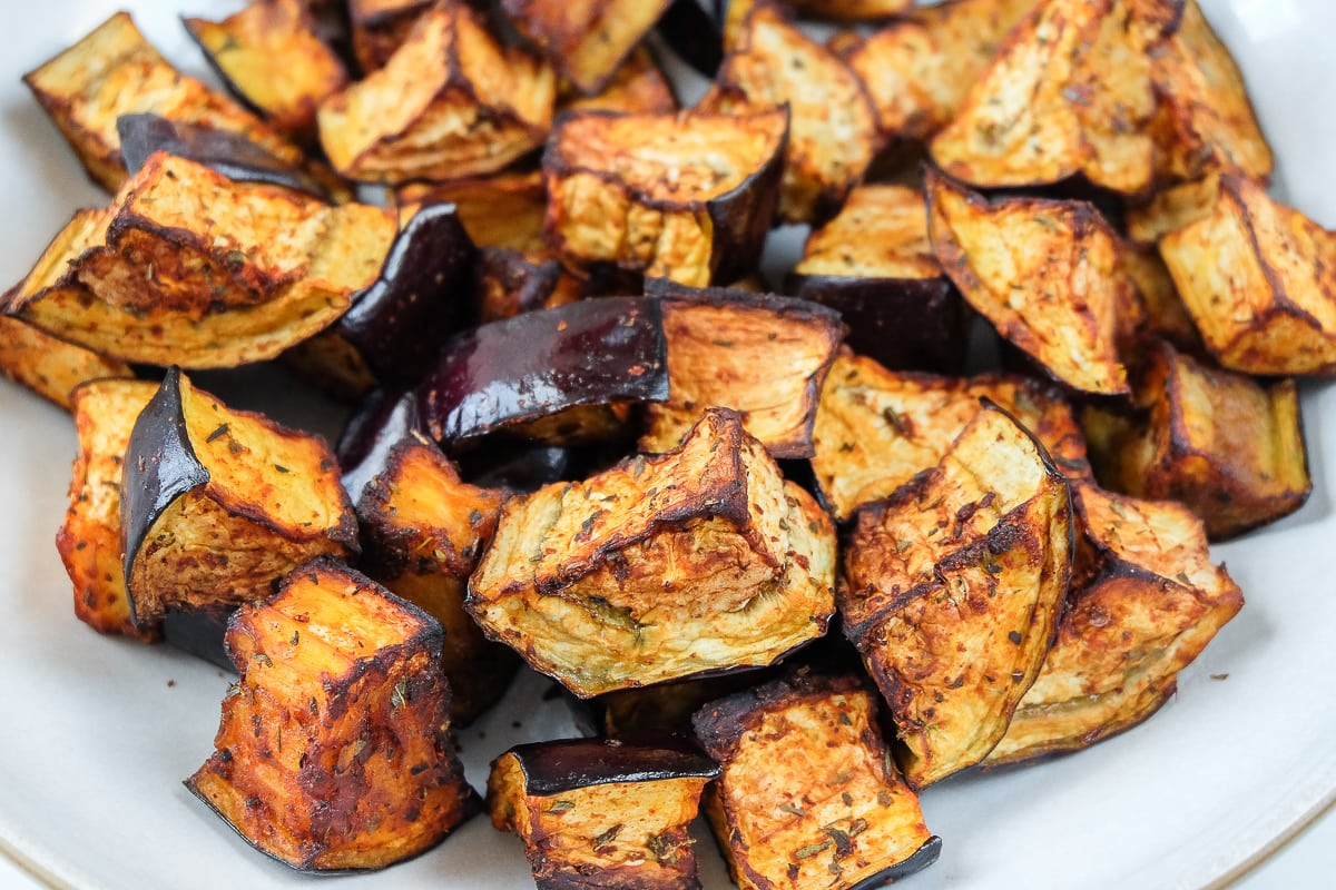 roasted eggplant in pieces in bowl on counter