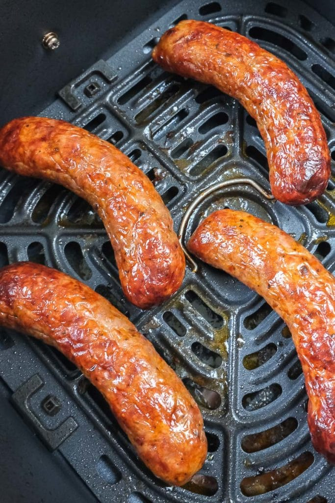 italian sausages in black air fryer tray