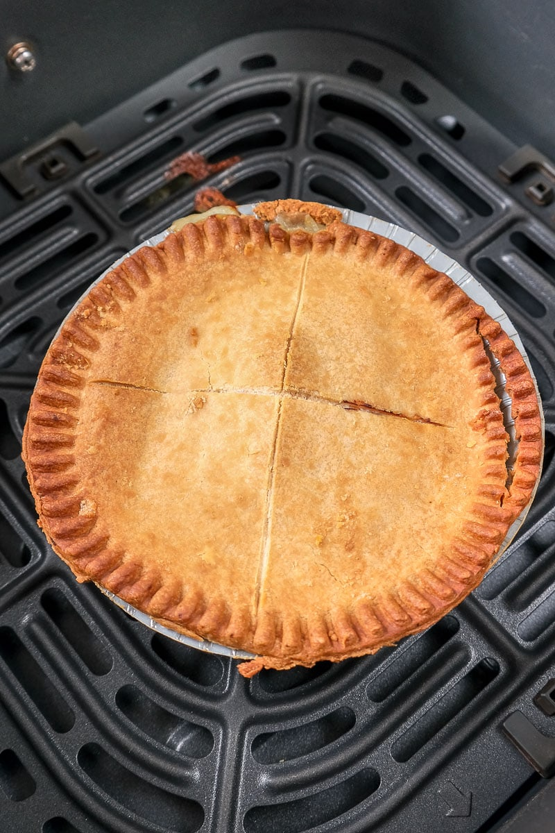 golden brown pot pie in black air fryer tray