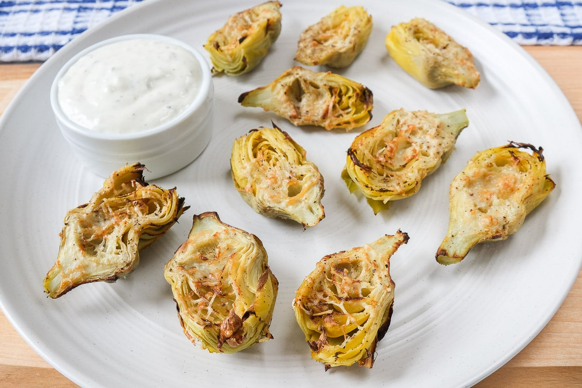 artichoke hearts with parmesan cheese on white plate