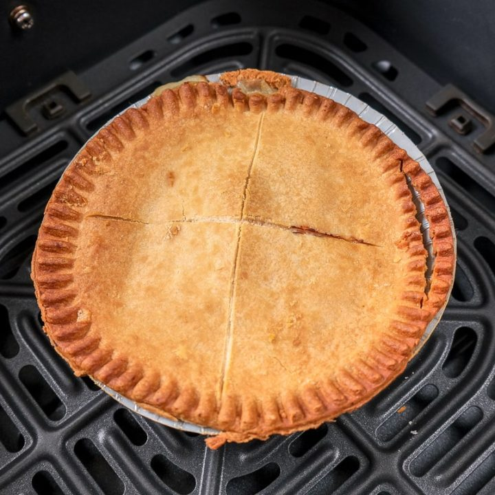 cooked pot pie in black air fryer tray